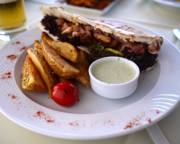 Chicken leg (gyros style) in pitta bread with grilled Santorini zucchini and yogurt-spearmint sauce