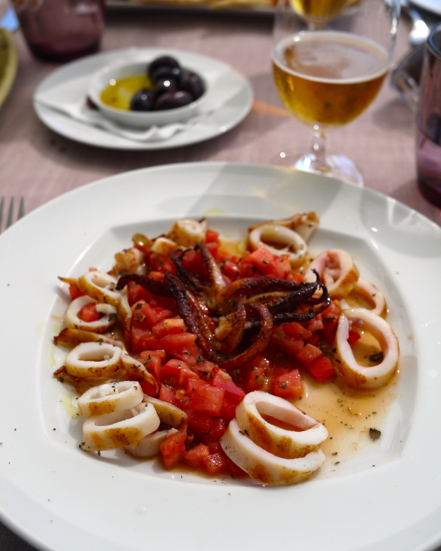 Grilled calamari served with freshly diced tomato, capers, and basil salad