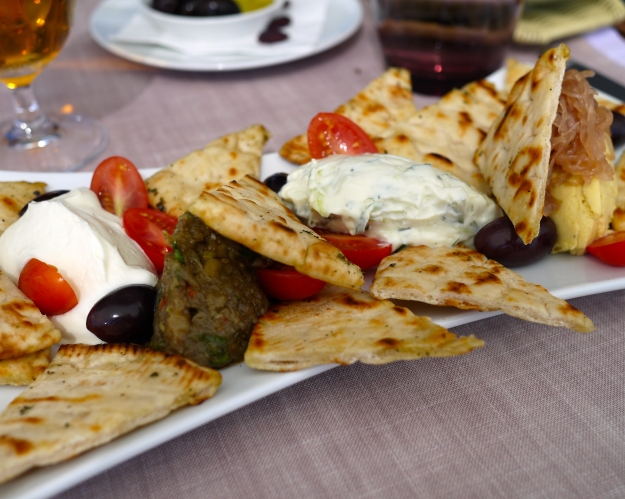 Traditionally inspired freshly fragrant selection of Greek dips with pita bread