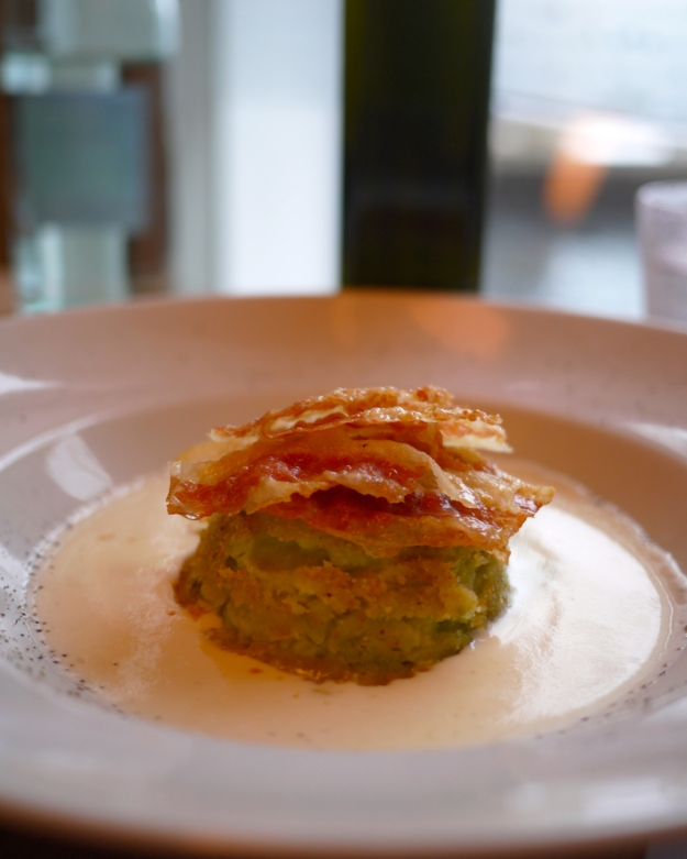 Cabbage flan with cheese fondue and crispy bacon