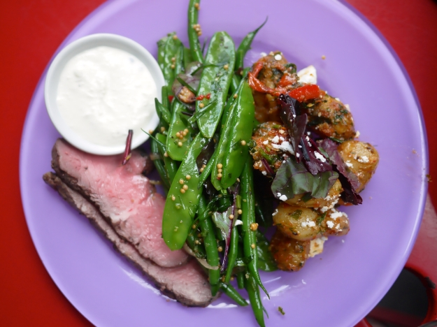Seared beef fillet with horseradish and green peppercorn sour cream sauce | Mixed green beans with red onion, chilli, mustard seeds and herbs | Jersey royals with yellow peppers, sun-dried tomatoes, feta, basil and mixed herbs