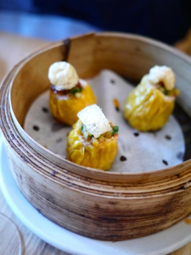 Pork and prawn dumplings topped with pork crackling