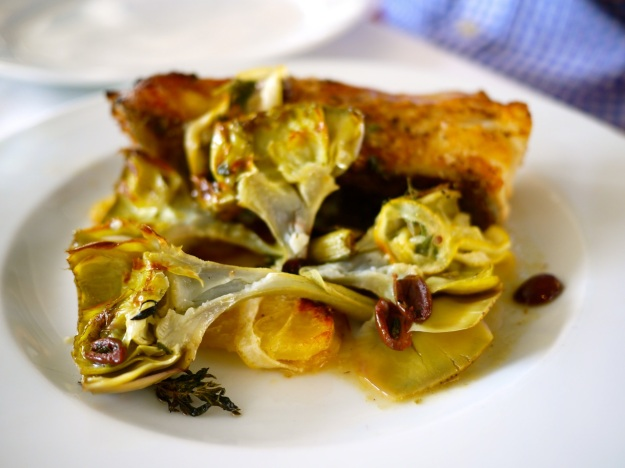 Rombo al forno – turbot tranche wood-roasted with lemon, olives & summer savory with violetta artichokes & potatoes 'al forno'