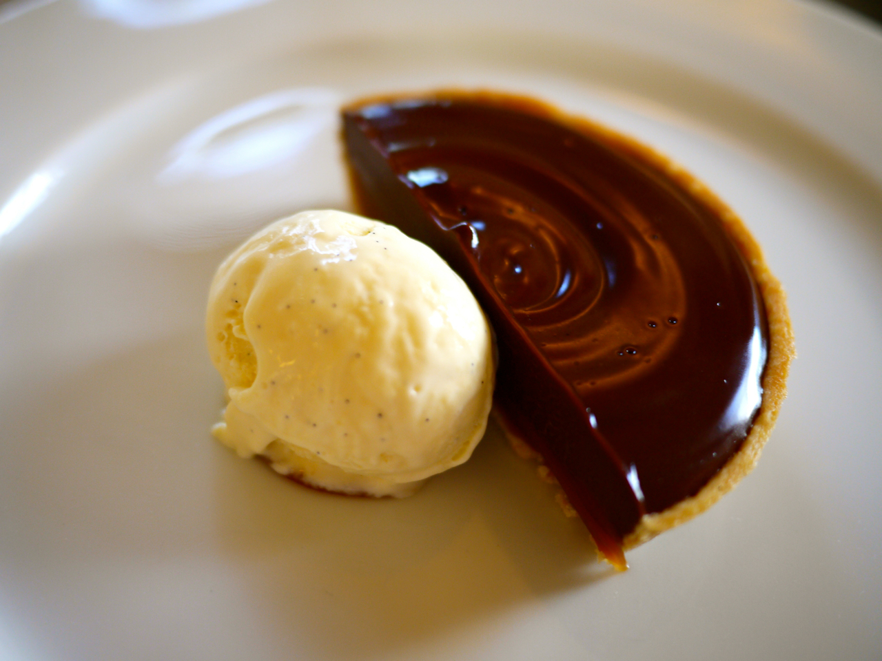 Chocolate and salted caramel tart with vanilla ice cream