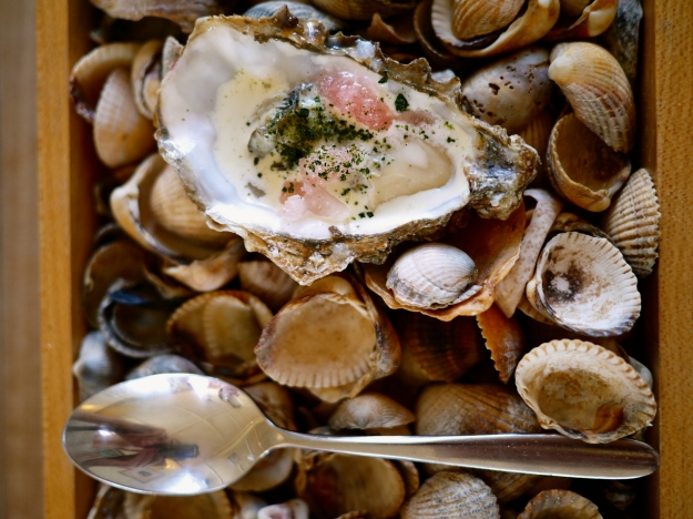 Poached oyster with cream rhubarb granita and crystalized seaweed