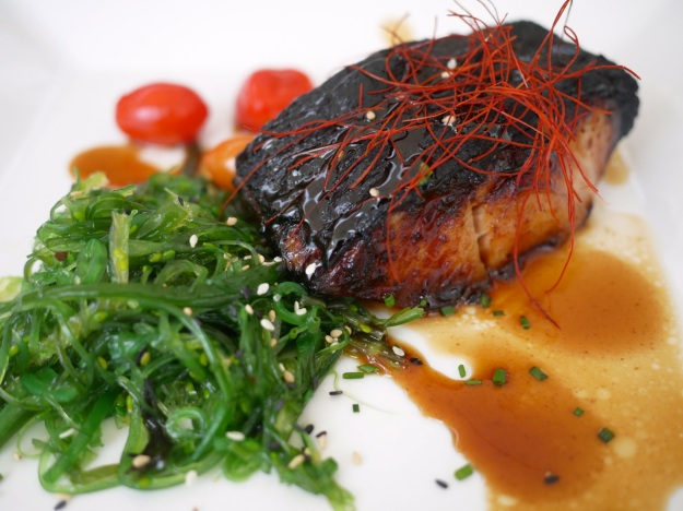 Black cod Alaska glazed with teriyaki sauce and served with a wakame salad