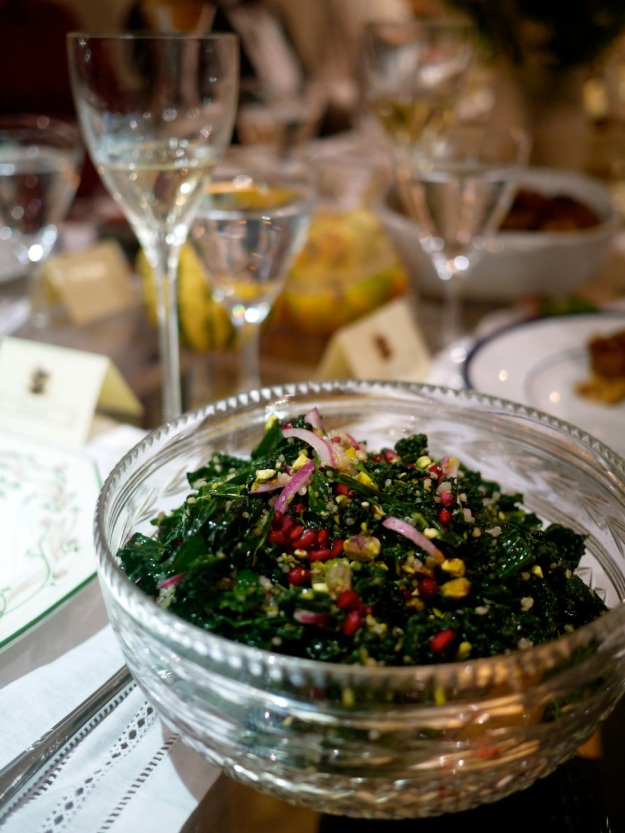 Tuscan kale salad with quinoa, red onion, pomegranate seeds and pistachios