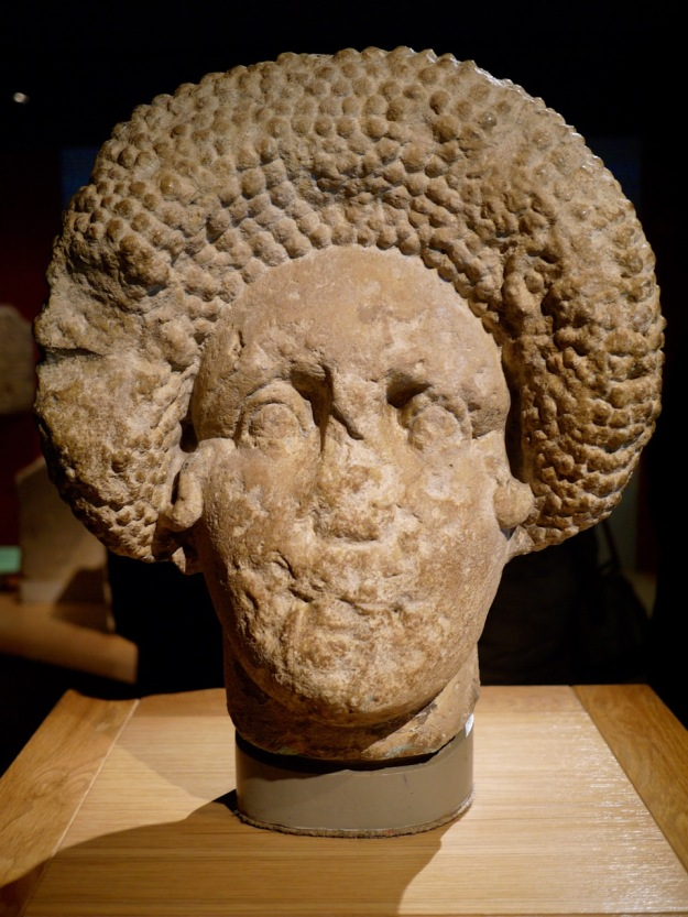 This stone head probably decorated the tomb of a wealthy lady. Her hair-do was fashionable in Rome in the later 1st century AD.