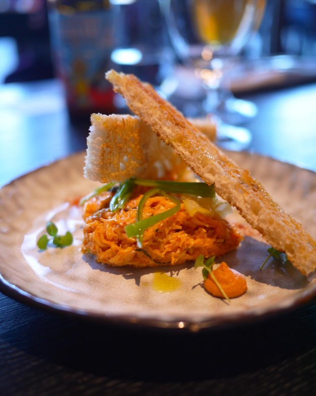 Crab salad on toast, with pickled peppers & citrus aioli