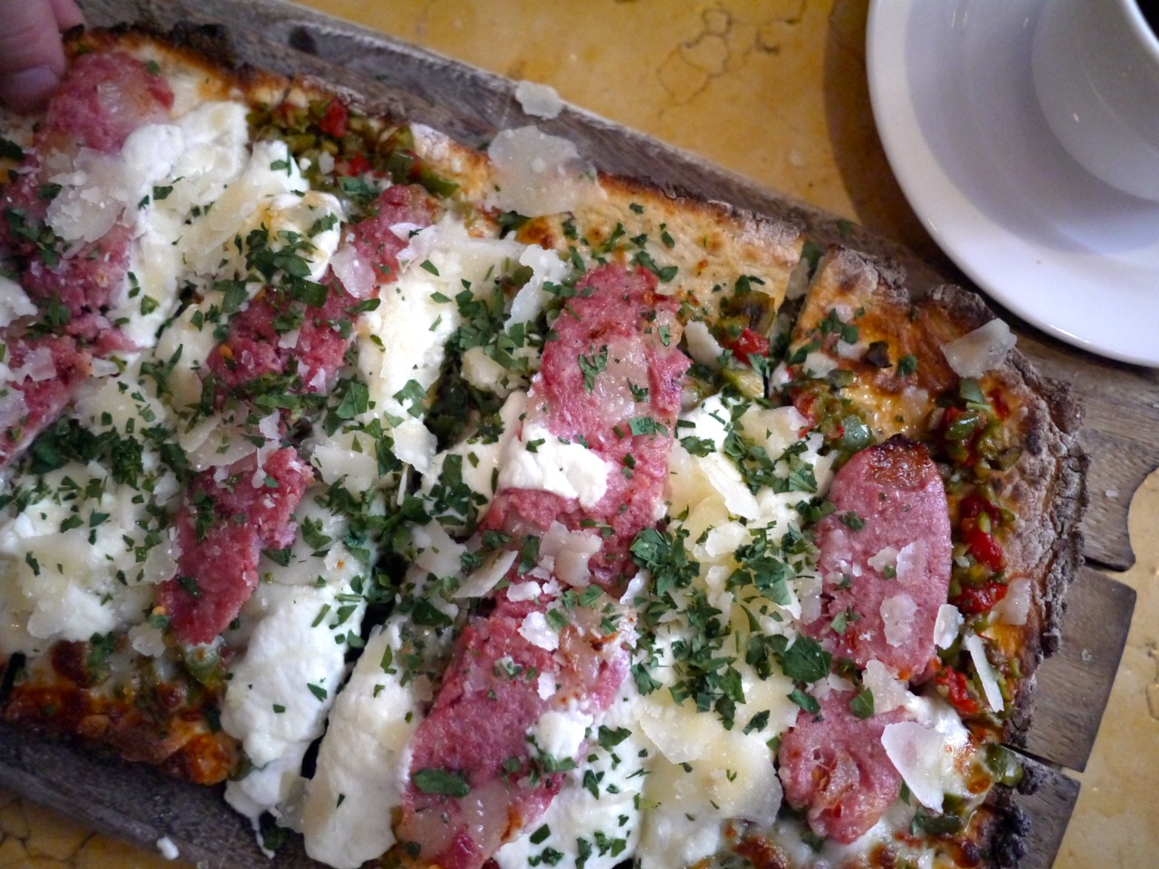 Spicy Muffaletta Flatbread Oil-Cured Soppressata, Olive Relish, Ricotta, Provolone