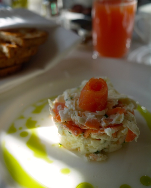 Smoked salmon and chive scrambled eggs with herb oil