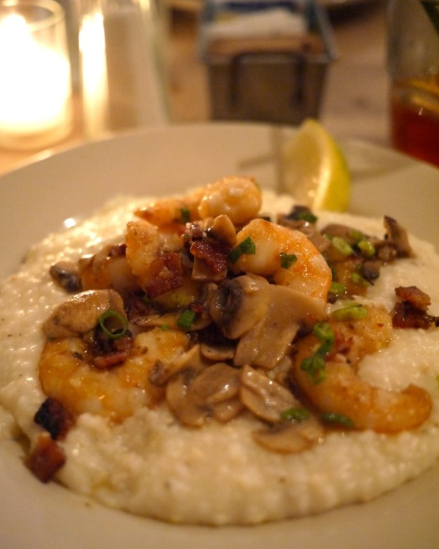 Shrimp & Grits: sautéd shrimp, mushrooms, scallions and bacon over cheese grits
