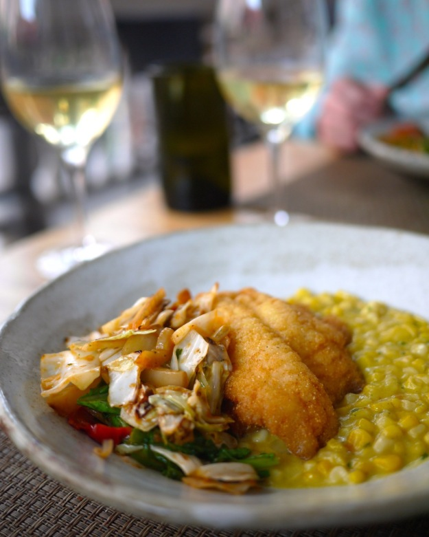 Cornmeal Dusted Catfish, FL Sweet Corn Creamed with Green Garlic, Fried Cabbage, Roasted Fennel and Peppers