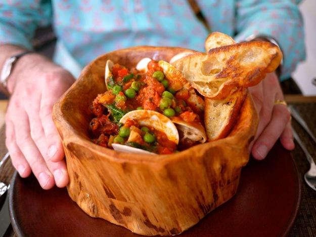Charleston Husk Fire Roasted Clams, HUSK Sausage, Preserved Tomato, Fennel, Ambrose Farms Pea Shoots, Garlic Toasts