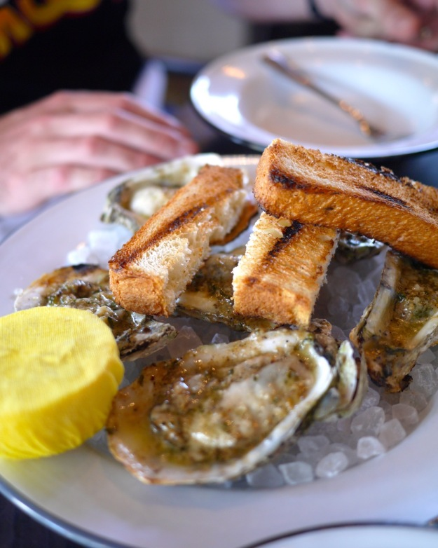 Char-grilled Oysters, lemon, parsley, butter, parmesan